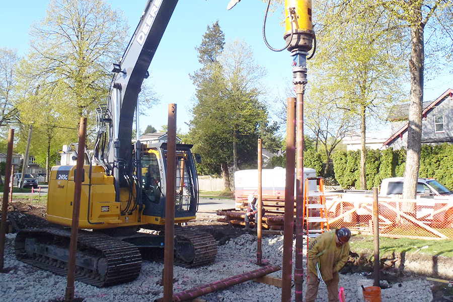 Pipe piles being installed into the peat bog