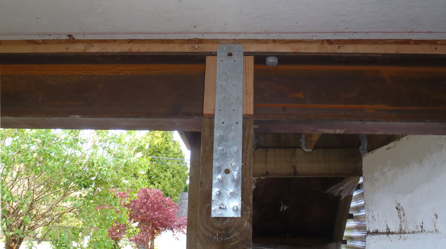 Repaired cross-beams after foundation settlement