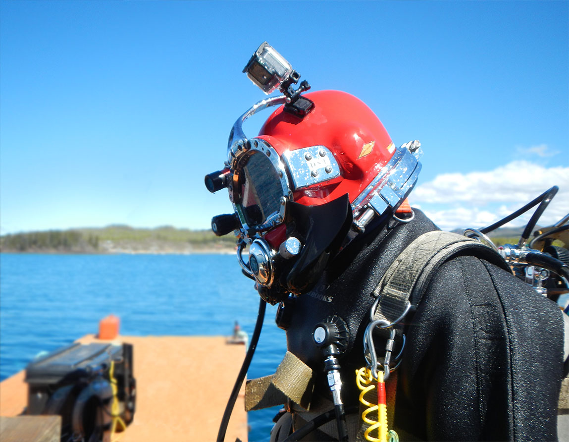 A diver preparing to install the geothermal exchange unit