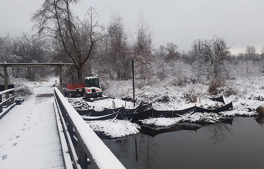 Winter bridge installation with helical piles
